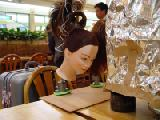 Mannequin heads clamped to the table next to me