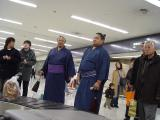 Sumo wrestlers (I assume) at the airport