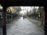 The path after the second gate, lined with brass lanterns